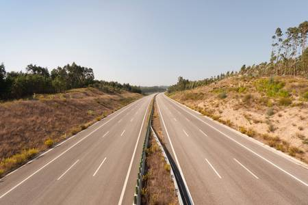 Aerial view of empty three lanes highway in Portugal photo