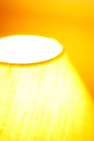 Vertical abstract of blured domestic lamp with warm colors