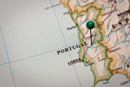 bathymetry: Closeup of a mark on impressed map of Portugal Stock Photo