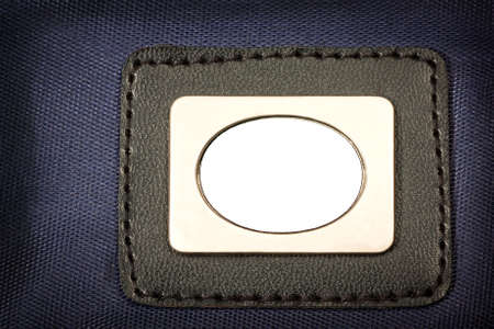 Metal Plate, with black border  inserted in blue fabric Stock Photo - 11532589