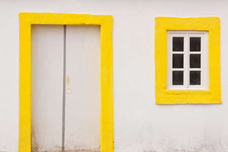 Close view of white and yellow old house photo