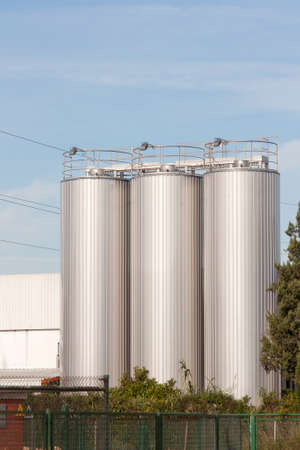 beer processing and storage silos against blue sky photo