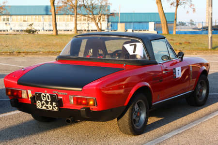 MARINHA GRANDE, PORTUGAL - FEBRUARY 11: A Fiat 124 Spider parked during 12th Classic and Sport Cars Meeting of Motor Club Of Marinha Grande, in Marinha Grande, Portugal on February 11, 2012.