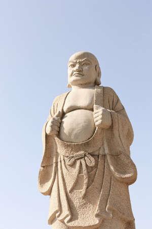 Marble buddha statue exhibited in an public garden