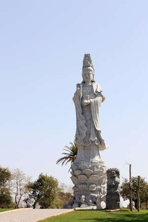 Twenty one meters buddha statue exhibited in an public garden