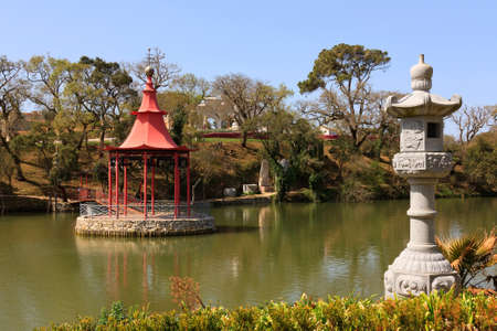 Oriental mediationstand on the middle of an public garden lake Stock Photo - 12946932