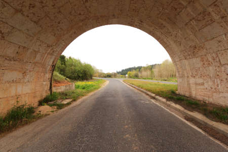 hardwoods: Man made road tunnel against woods and cloudy sky Stock Photo