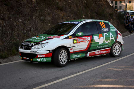 CASTELO BRANCO, PORTUGAL - MARCH 10: Jo�o Ruivo drives a Peugeot 206 GTI during Rally Castelo Branco 2012, integrated on Open Championship in Castelo Branco, Portugal on March 10, 2012.