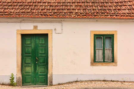 Abandoned facade with wood windows and doors in Portugal photo