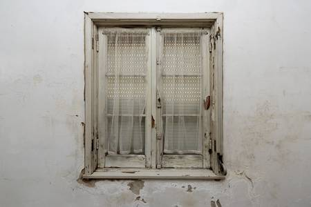 View of closed wood window inside an house
