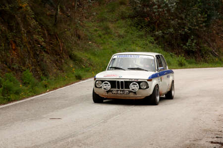 LEIRIA, PORTUGAL - APRIL 20: José Grosso drives a BMW 2002 during Day One of Rally Verde Pino 2012, in Leiria, Portugal on April 20, 2012.