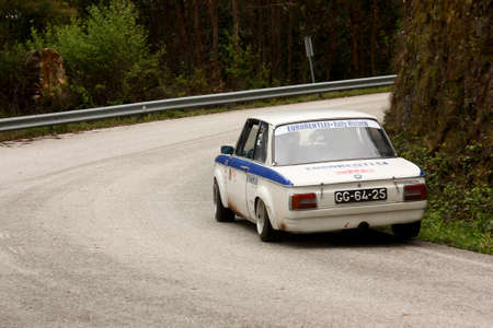 hillclimb: LEIRIA, PORTUGAL - APRIL 20: Jos� Grosso drives a BMW 2002 during Day One of Rally Verde Pino 2012, in Leiria, Portugal on April 20, 2012. Editorial