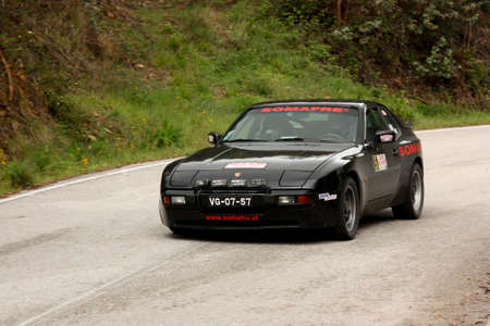 hillclimb: LEIRIA, PORTUGAL - APRIL 20: Rui Viana drives a Porsche 944 during Day One of Rally Verde Pino 2012, in Leiria,  Portugal on April 20, 2012.