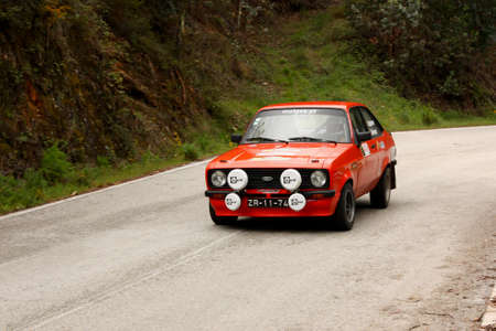 hillclimb: LEIRIA, PORTUGAL - APRIL 20: Goncalo Figueiroa drives a Ford Escort MkII during Day One of Rally Verde Pino 2012, in Leiria,  Portugal on April 20, 2012.  Editorial
