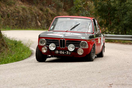 hillclimb: LEIRIA, PORTUGAL - APRIL 20: Paulo Marques drives a BMW 1600 during Day One of Rally Verde Pino 2012, in Leiria,  Portugal on April 20, 2012. Editorial