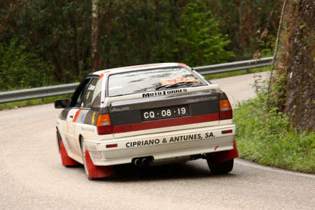 hillclimb: LEIRIA, PORTUGAL - APRIL 20: Cipriano Antunes drives a Audi Quattro during Day One of Rally Verde Pino 2012, in Leiria,  Portugal on April 20, 2012.  Editorial