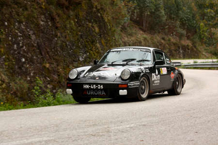 hillclimb: LEIRIA, PORTUGAL - APRIL 20: Joao Mexia Leitao drives a Porsche 911 Coupe during Day One of Rally Verde Pino 2012, in Leiria,  Portugal on April 20, 2012.