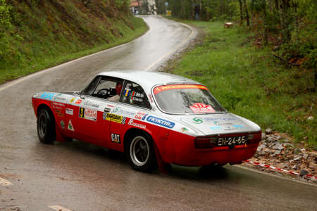 hillclimb: LEIRIA, PORTUGAL - APRIL 21: Adalberto Melim drives a Alfa Romeo 2000 GT during Day Two of Rally Verde Pino 2012, in Leiria,  Portugal on April 21, 2012. Editorial
