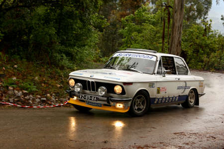 hillclimb: LEIRIA, PORTUGAL - APRIL 21: Antonio Alberto Santos drives a BMW 2002 during Day Two of Rally Verde Pino 2012, in Leiria,  Portugal on April 21, 2012. Editorial