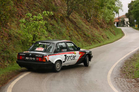 LEIRIA, PORTUGAL - APRIL 21: Sergio Carvalho drives a BMW E30 during Day Two of Rally Verde Pino 2012, in Leiria,  Portugal on April 21, 2012.