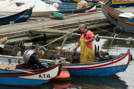 AVEIRO, PORTUGAL - JULY 4: fishermen preparing for fishing on the Ria of Aveiro, in �veiro, Portugal on July 4, 2012 Stock Photo - 14418644
