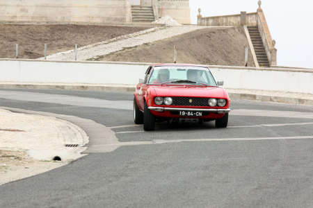 hillclimb: FOZ DO ARELHO, PORTUGAL - MAY 13: Luis Santos drives a Fiat Dino Coupe during Rally Sprint Foz do Arelho 2012, in Foz do Arelho, Portugal on May 13, 2012 Editorial