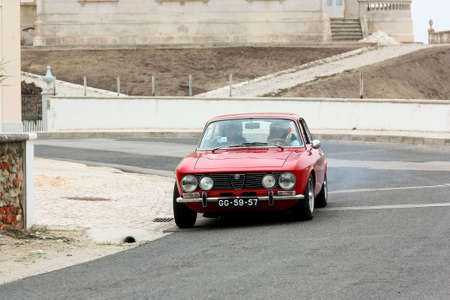 hillclimb: FOZ DO ARELHO, PORTUGAL - MAY 13: Alberto Fonseca drives a Alfa Romeo GTV during Rally Sprint Foz do Arelho 2012, in Foz do Arelho, Portugal on May 13, 2012
