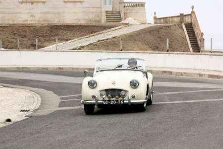 hillclimb: FOZ DO ARELHO, PORTUGAL - MAY 13: Jos� Ferreira drives a Triumph TR2 during Rally Sprint Foz do Arelho 2012, in Foz do Arelho, Portugal on May 13, 2012