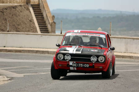hillclimb: FOZ DO ARELHO, PORTUGAL - MAY 13: Bruno Pereira drives a Datsun 1200 during Rally Sprint Foz do Arelho 2012, in Foz do Arelho, Portugal on May 13, 2012