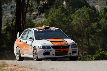 POMBAL, PORTUGAL - SEPTEMBER 22: Miguel Barbosa drives a Mitsubishi Lancer EVO IX during Rally Centro de Portugal 2012, in Pombal, Portugal on September 22, 2012. Editorial