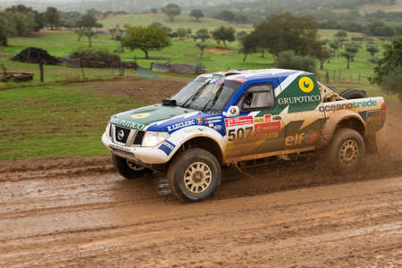 PORTALEGRE, PORTUGAL - NOVEMBER 3: Helder Oliveira drives a Nissan Navara in BAJA 500, integrated on FIA World Cup for Cross-Country Rallies, in Portalegre, Portugal on November 3, 2012.