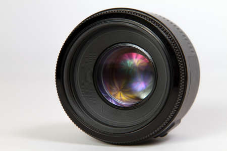 50 mm photographic lens against white background photo
