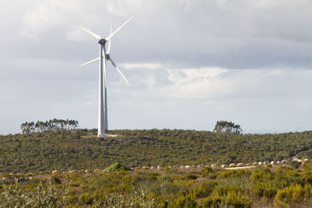 An pair of windmills turbines on the top of an hill Stock Photo - 16587054