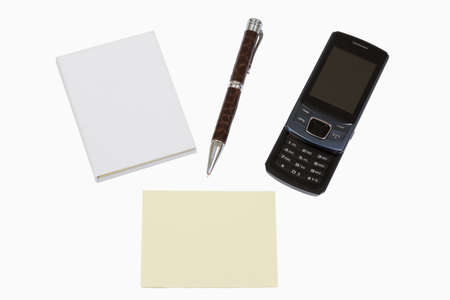 Book, Pen, empty post-it and mobile phone isolated on white background