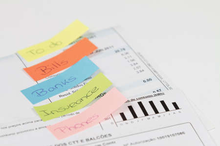 Some bills to pay with some post-it words Stock Photo - 17446423