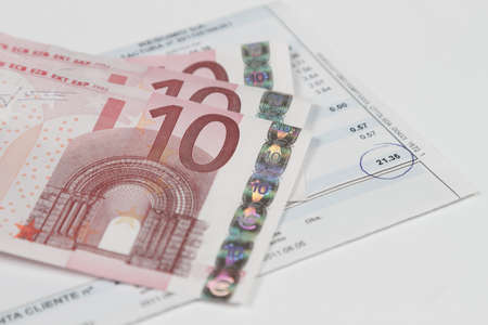 Bill to pay with some euro banknotes above  photo