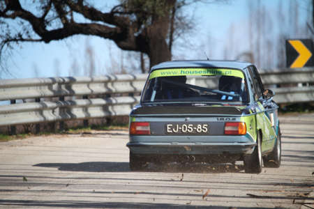 LEIRIA, PORTUGAL - FEBRUARY 2: Alberto Pereira drives a BMW 1602 during 2013 Amateur Winter Rally, in Leiria, Portugal on February 2, 2013.