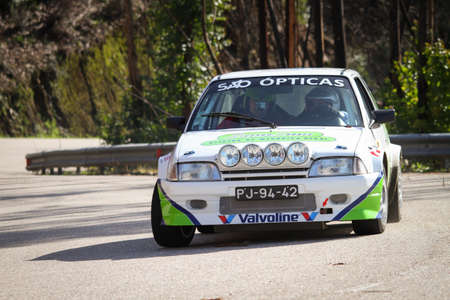 LEIRIA, PORTUGAL - FEBRUARY 2: Ricardo Soares drives a Citroen AX during 2013 Amateur Winter Rally, in Leiria, Portugal on February 2, 2013.