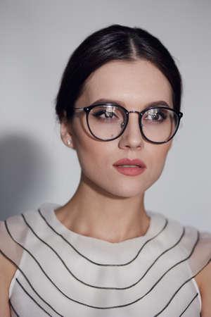 Eyewear glasses woman closeup portrait. Beautiful Young European Girl. Stock Photo