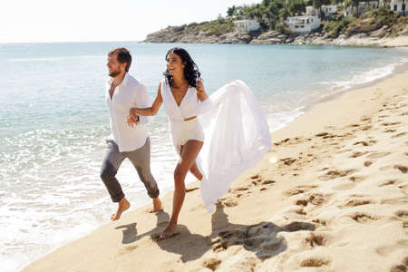 Beautiful stylish couple just married, have escape in Greece in summer time, perfect sunny day. Imagens