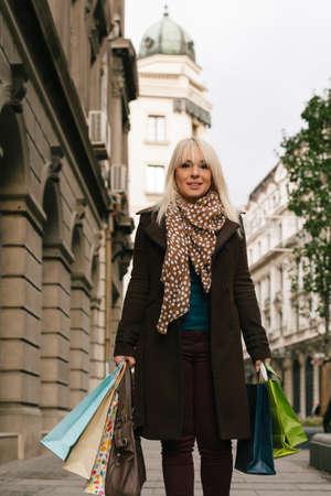 Beautiful woman walking with shopping bags