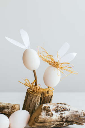 log basket: Easter concept. White eggs with bunny ears