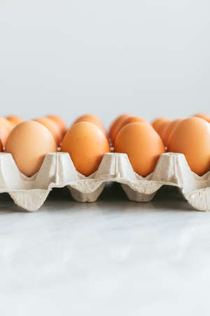 Raw and fresh eggs. Egg carton with copy space