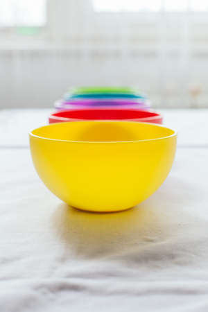 emphty: Closeup of colorful bowls with copy space Stock Photo