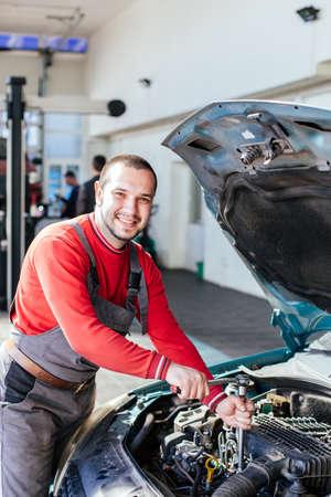 Portrait of mechanic smiling in auto repair service