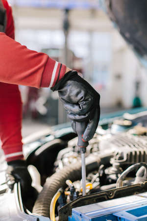 skill: Closeup of mechanic hands in auto service