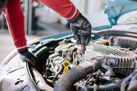 Closeup of mechanic hands in auto service