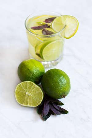Fresh lemonade in glass with soda, lemon, lime and mint Stock Photo