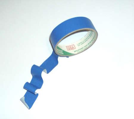 Un rollo de cinta adhesiva de color azul  Foto de archivo - 1666217