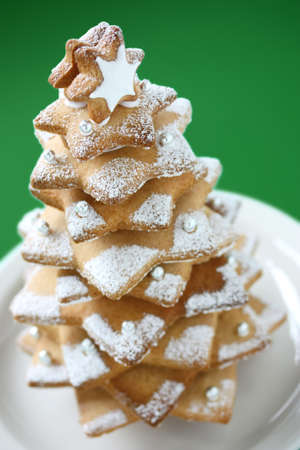 cookie christmas tree on green background photo